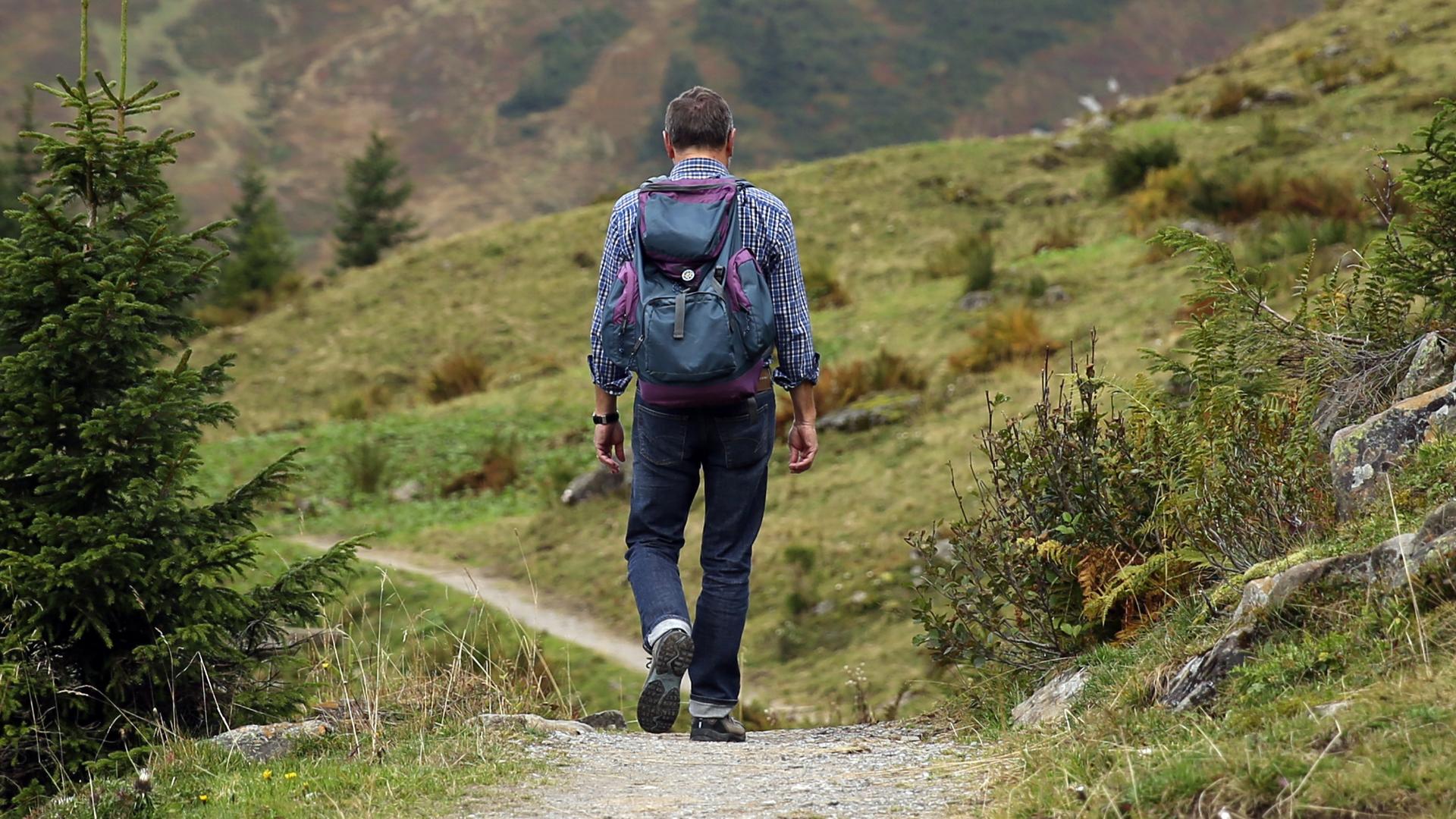 man-trekking-in-the-mountain