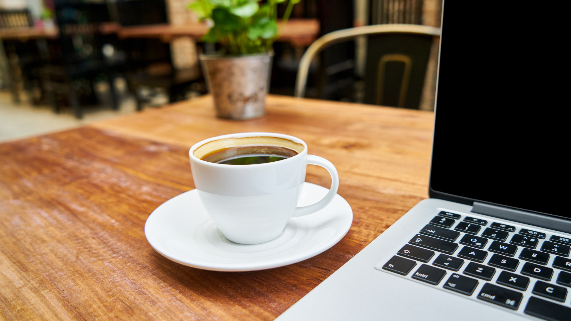 coffee-and-laptop-on-a-wooden-table